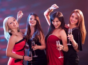 Stylish women toasting with champagne