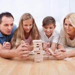 Happy Family Playing With The Wooden Blocks