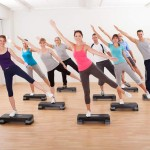 Class doing aerobics balancing on boards